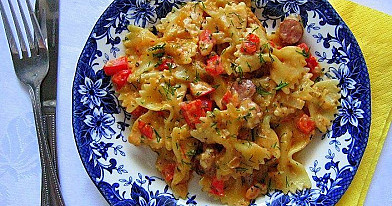 Pasta with smoked sausages and sour cream - tomato sauce