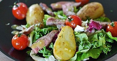 Salad with beef, fresh potatoes and tomatoes
